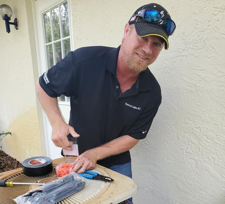 Owner Brian Lucas Working Repairing an AC unit