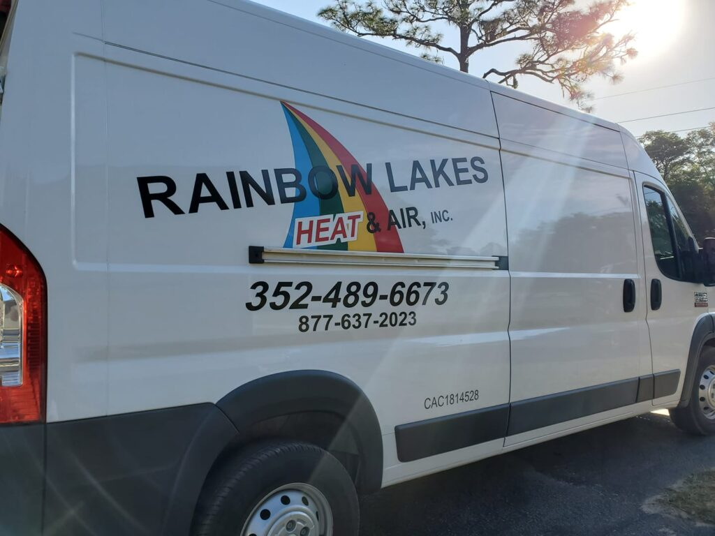 Rainbow Lakes Heating and Air Conditioning truck sitting in the summer sun.